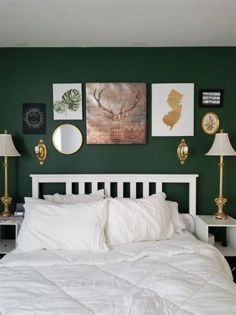 dark green accent wall  gold details green accent