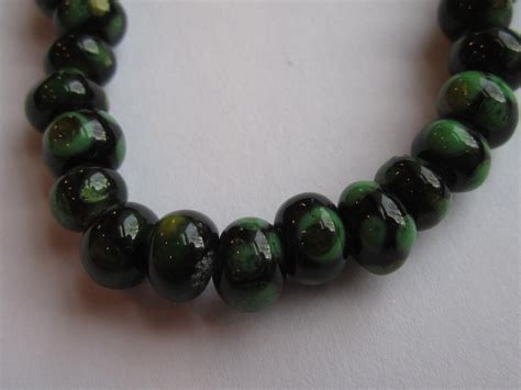 bead world palatine il lwork glass black with yellow and green