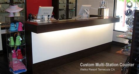 Display Work Apparel On Showroom Floors - image detail for custom retail counters design a custom