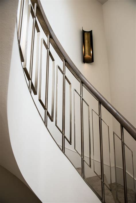 stainless steel banister graceful curve of helix staircase by john desmond ltd