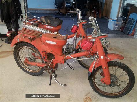 two 1966 honda 90 motorcycle