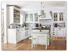 white kitchen cabinets with gothic arch glass front doors white kitchen cabinets with gothic style arched muntins