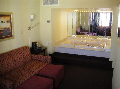 living room east hton living room and jacuzzi picture of four queens hotel and