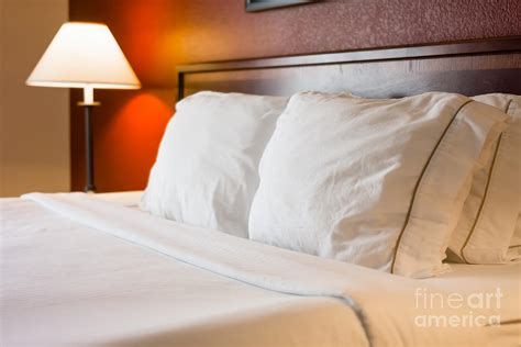 hotel bed pillows hotel room bed and pillows photograph by paul velgos