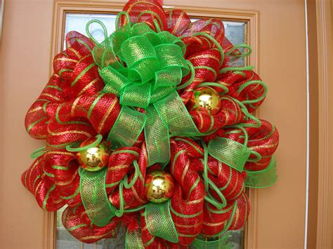 decorative mesh for doors decorating a christmas wreath with ribbon
