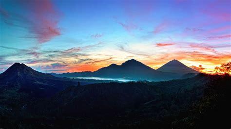wallpapers free hd 1366x768 download wallpaper 1366x768 mountains sky bali sunrise