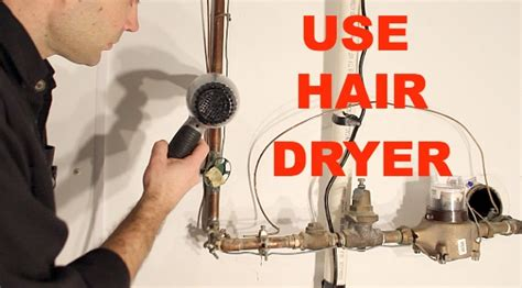 Use A Hair Dryer As A Heat Gun thawing and preventing frozen pipes in bathrooms