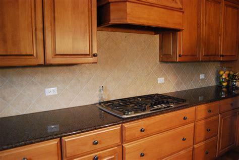 cherry kitchen cabinet design with kitchen hood and cream tin backsplash also black granite