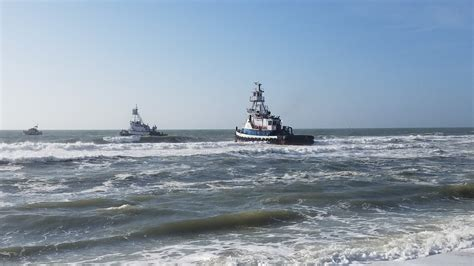 tugboat nj tugboat breaks mooring and runs aground on jersey shore