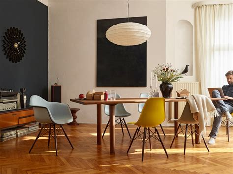 Buy the vitra dsw eames plastic side chair dark maple base at nest co uk