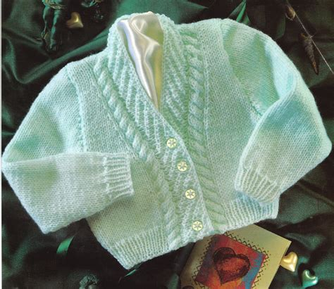 unique knitting patterns baby cardigan 12 quot 22 quot dk cable diagonal rib