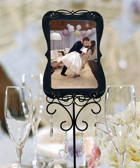picture frame centerpiece ideas vintage picture frame centerpiece our story wedding ideas pinte