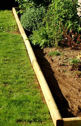 Finish Off Flower Beds In Style With Landscape Timbers Installing Landscape Edging