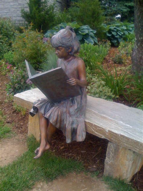 bronze statue   girl reading blowing rock nc