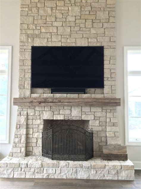 Flat Screen Tv Mounted Fireplace by Flats Stones And Tvs On