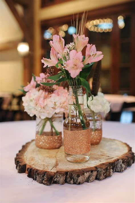 tree centerpiece ideas rustic tree stump centerpieces with jars and pink