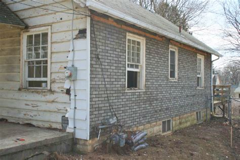this old house siding renovating an old house stock photo workers and bulldozer renovating old house in