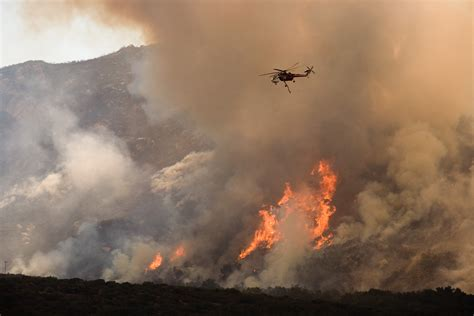 Wildfire At a helicopter drops water on the wildfire in california