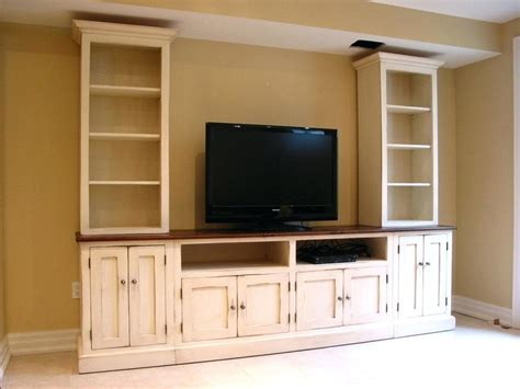 using ikea kitchen cabinets for entertainment center diy built in entertainment center modern built in
