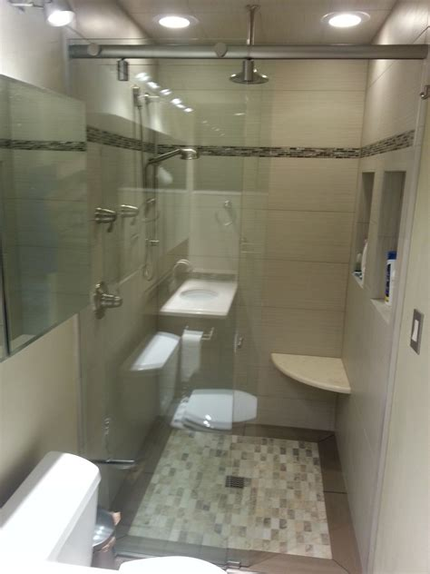 small bathroom  inset tile floor curbless shower