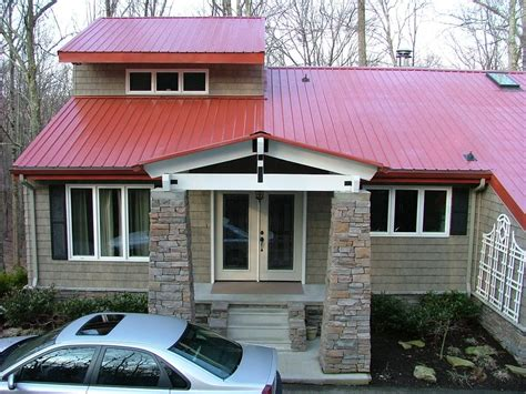 country metal roof exterior of house new metal roof stack rock columns and vinyl