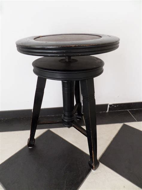 Adjustable Wooden Piano Stool by A Black Wooden Piano Stool Adjustable In Height Catawiki