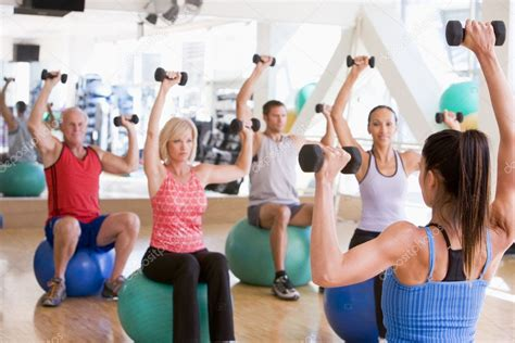 Rpac Fitness Classes 5 by Instructor Taking Exercise Class At Stock Photo