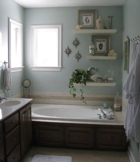 who invented bathrooms a few wall shelves this bathroom was re invented great