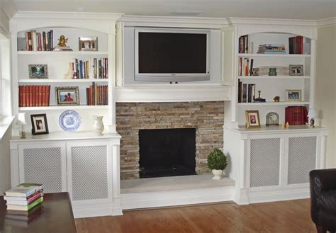 Built in shelves around brick fireplace built in bookcases around a