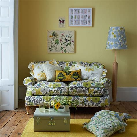 yellow country style living room with floral sofa living
