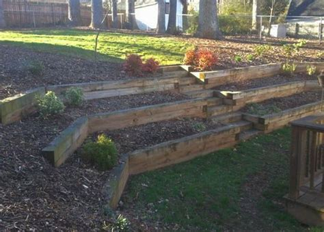 backyard landscaping effect with tiered railroad tie