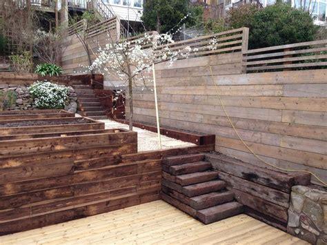 reclaimed scaffold board fence  awkward heavily sloped