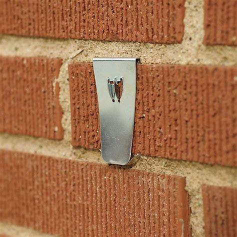 how to hang christmas lights on brick wall how to hang wreaths on a brick wall bricks and home