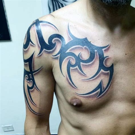 tribal tattoo chest and arm sharp design black ink tribal style ornament