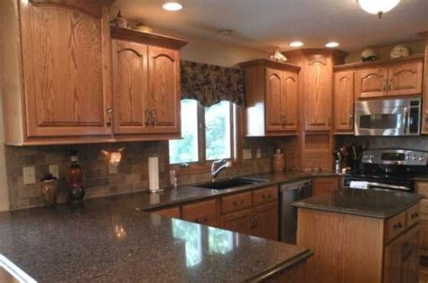 oak cabinets with dark brown countertop google search pictures of oak cabinets with quartz countertops google