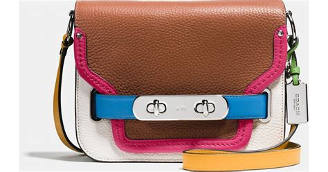 Sale Coach Ebanis Rainbow 3323 1 coach swagger shoulder bag in rainbow colorblock leather in brown lyst