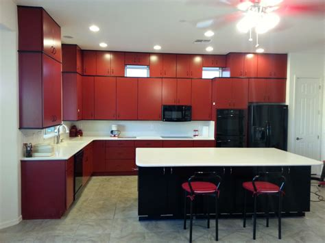 red and black kitchen cabinets phoenix kitchen remodel red cabinets black island white countertops