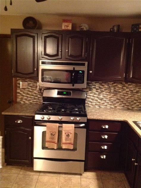 dark mahogany kitchen cabinets after general finish gel stain in dark mahogany love this