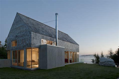 Coastal Home Interiors cedar shingles cascading down a modern courtyard house