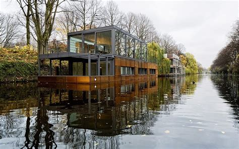 floating boat house modern floating boat house is full of steel and wood pics