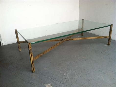 glass top metal base coffee table large glass top coffee table with gold leaf finish on the metal base at 1stdibs