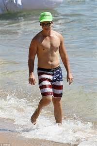 beach bodies daily record miles teller catches some rays with his bikini babe