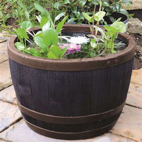 Oak Half Barrel Planters by Blenheim Black Oak Copper Effect Half Barrel Planter