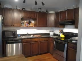 marvelous Kitchen Island Decorating Ideas #2: Dark-Wooden-Kitchen-Cabinet-with-Stainless-Steel-Appliances-for-Formal-Kitchen-Decorating-Ideas.jpg