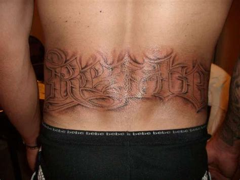 lower back name tattoos last name on lower back