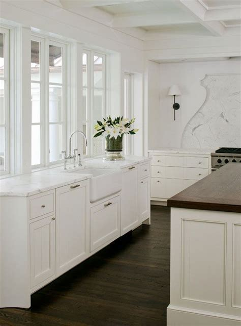 white kitchen cabinets with dark hardwood floors white kitchen cabinets dark wood floors for the house