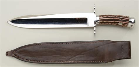 modern bowie knife large custom made modern bowie knife with tooled leather