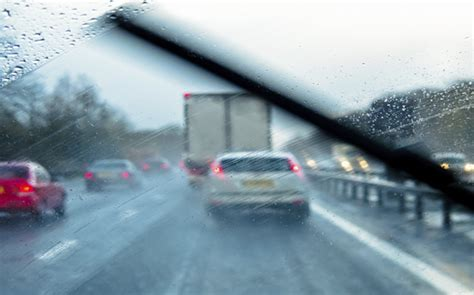 Standing In The Rain by 10 Tips For Driving In The Rain Mercury Insurance