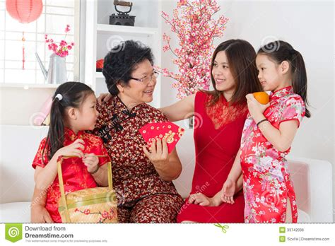 asian family celebrate new year at home royalty