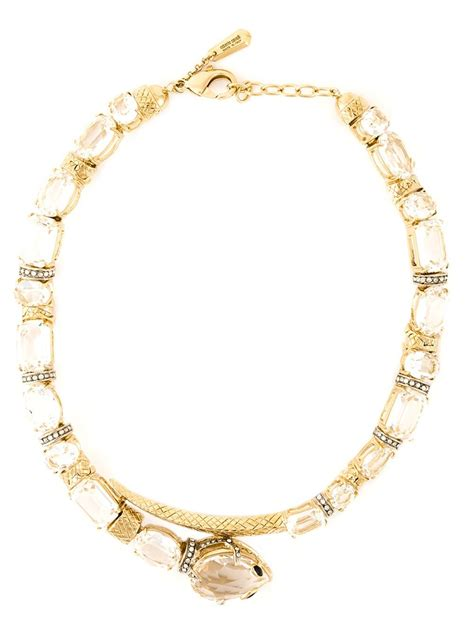 Outfitters Snake Bangle An Affordable Alternative To Roberto Cavalli Serpent Motifs by Roberto Cavalli Swarovski Snake Necklace In Gold Metallic